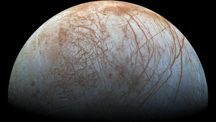 The criss-crossed, icy surface of Europa