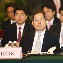 Chun Yung Woo sitting at a lectern