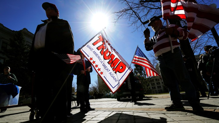 "Supporters of President Trump attend a ""Spirit of America"" rally in Denver on February 27, 2017."