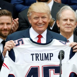 President Trump holds up a jersey with his name on it
