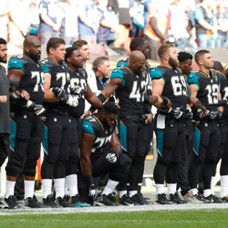 Patrick Omameh of the Jacksonville Jaguars kneels during the U.S. national anthem before a match in September 2017