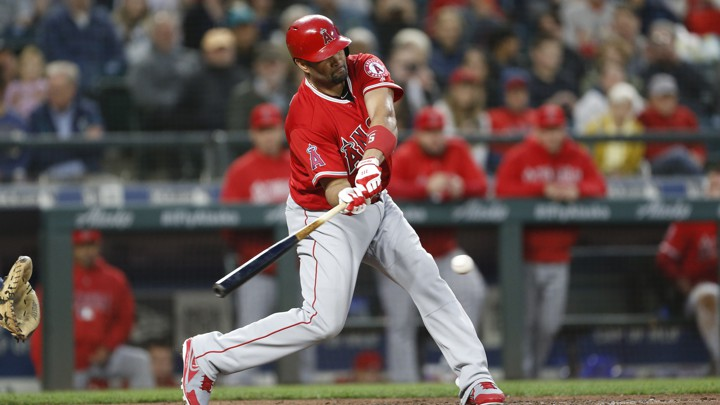 Los Angeles Angels first baseman Albert Pujols (5) connects on his 3,000th career hit against the Seattle Mariners during the fifth inning at Safeco Field