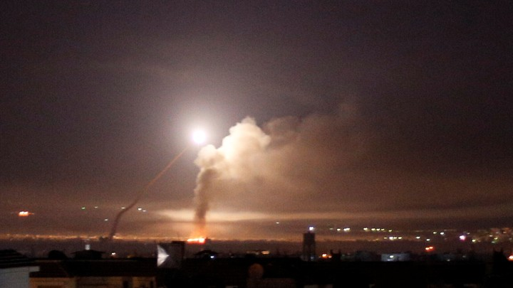 Missile fire is seen from Damascus