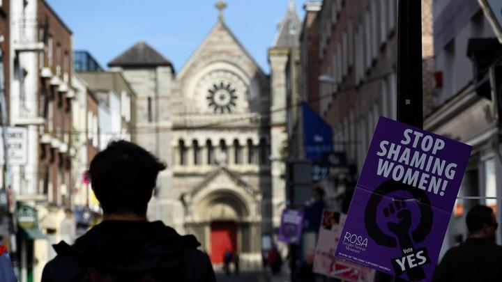 A man walks past a referendum poster