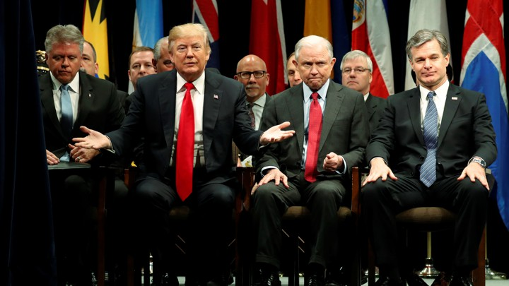 Trumps directives to the fbi really are a threat to democracy the a curtain parts to reveal president trump onstage with attorney general jeff sessions and fbi director christopher wray as he participates in a graduation m4hsunfo