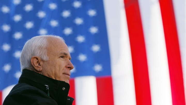 John McCain in front of an American flag