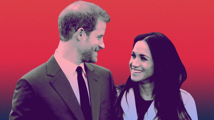 Prince Harry and Meghan Markle smiling at each other
