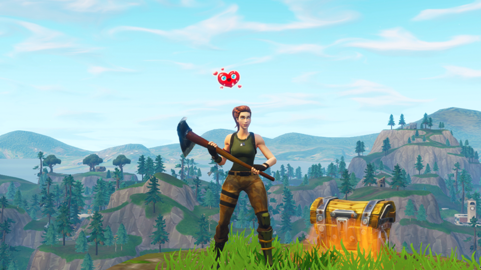 An animated woman with a heart floating over her head stands next to a treasure chest while holding an ax.