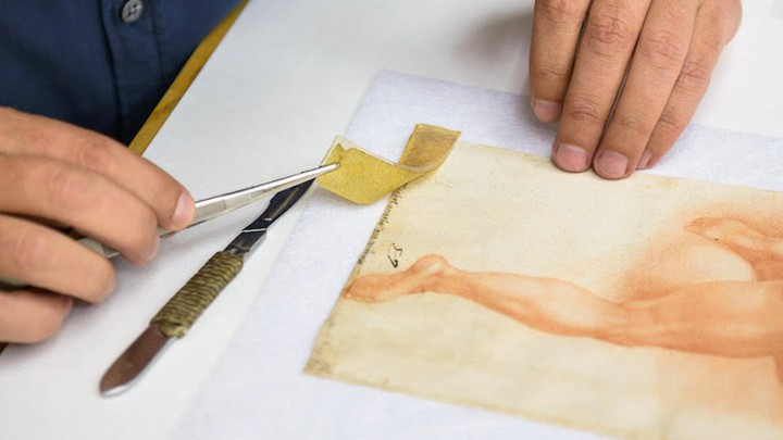 Yellow tape being peeled off a sketch of a leg