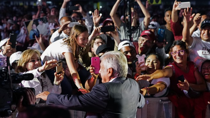 Amlo with smiling supporters