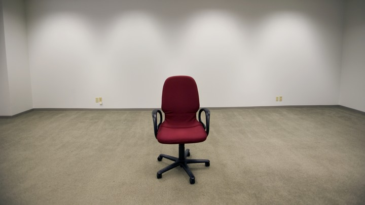 An office chair sitting in an empty room