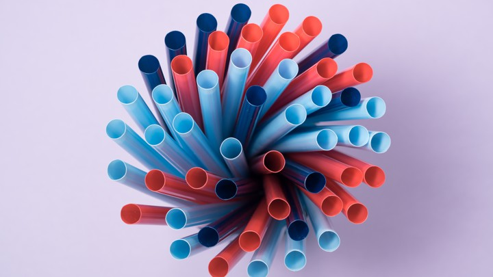 A collection of pink and blue plastic straws
