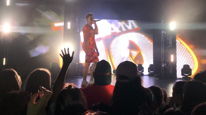 Jake Paul on stage holding a microphone