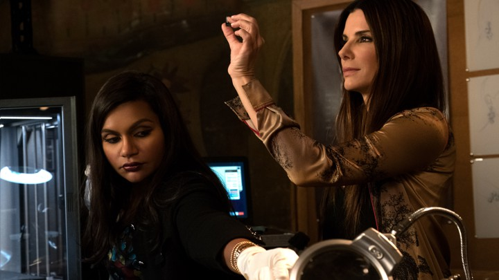 Amita (Mindy Kaling) and Debbie (Sandra Bullock) examine counterfeit jewels in 'Ocean's 8'