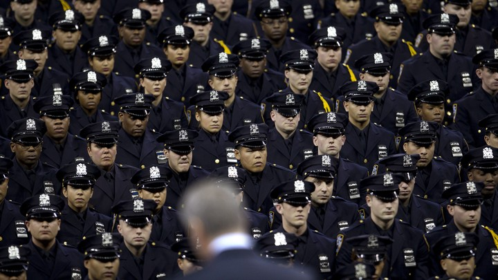 Dozens of police officers in uniform