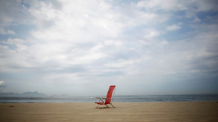 A folding chair on a beach