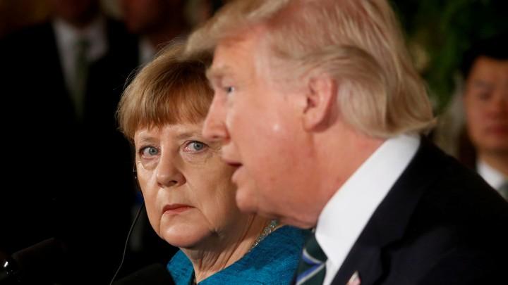 Chancellor Merkel looking at President Trump