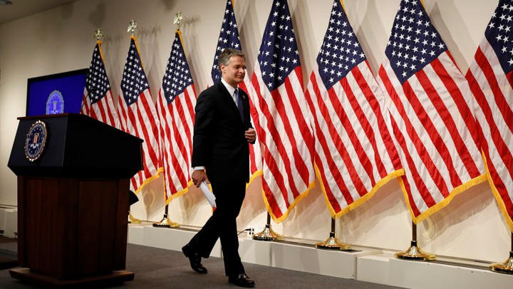 FBI Director Christopher Wray leaves a news conference on the new Inspector General report on Thursday.