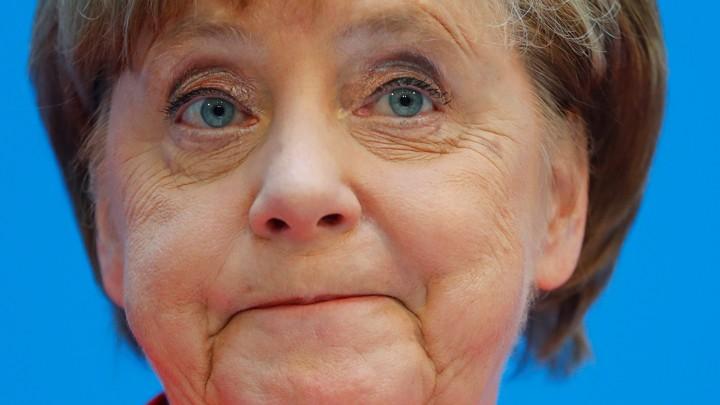 A close-up of Angela Merkel frowning