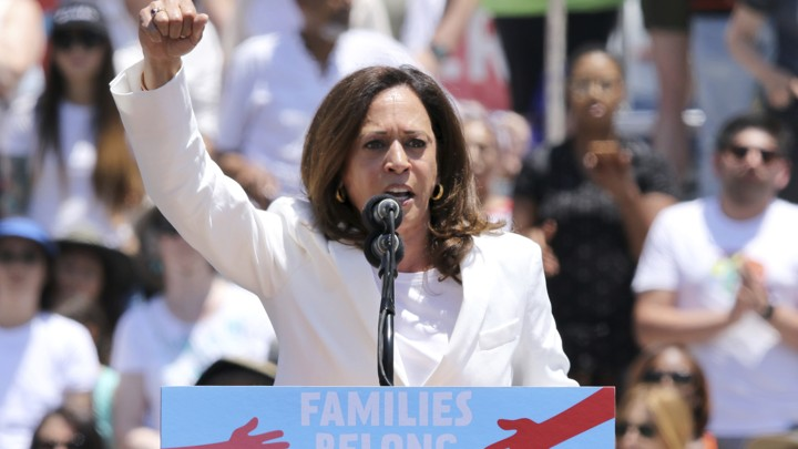 The California senator Kamala Harris raises her right fist at an immigration rally in Los Angeles