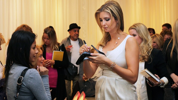 Ivanka Trump signs a shoe from her line
