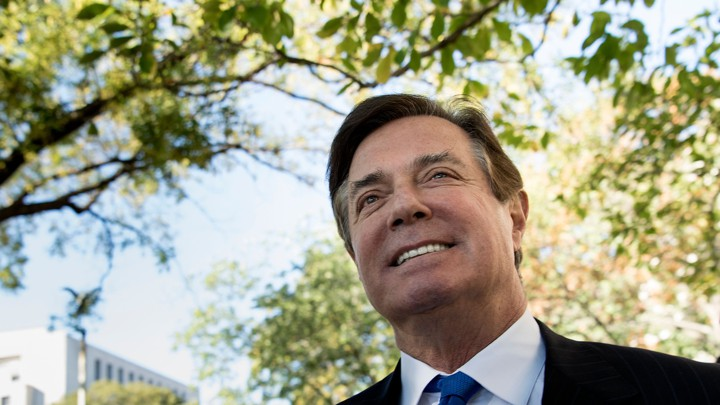 Paul Manafort is photographed smiling as he leaves the E. Barrett Prettyman United States Court House after being charged on October 30, 2017