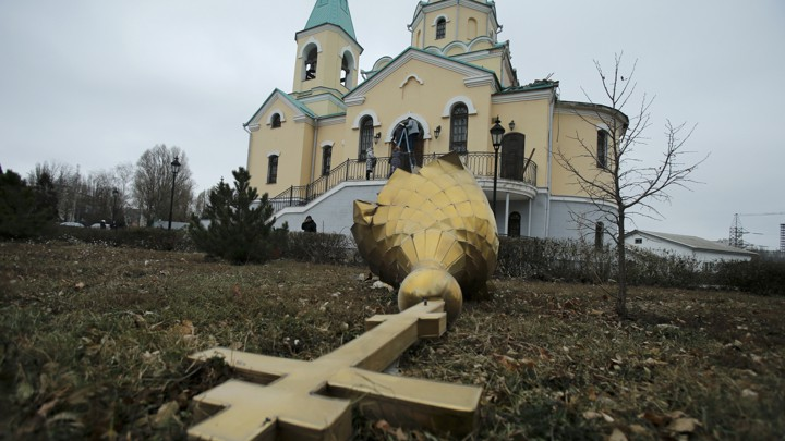 A damaged dome in the yard of an Orthodox church damaged by shelling in Donetsk, eastern Ukraine, in 2014