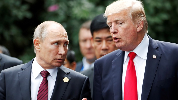 us president donald trump and russias president vladimir putin talk during the family photo session at