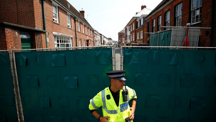 A police officer stands guard in the English town of Amesbury on July 5, 2018.