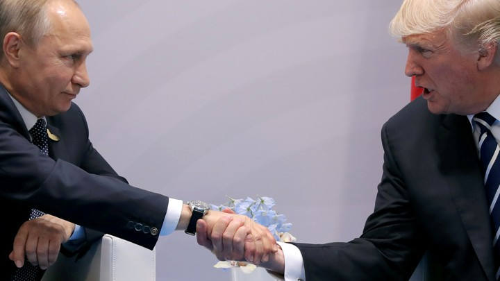 us president donald trump shakes hands with russian president vladimir putin during the their bilateral meeting
