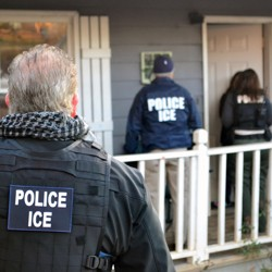 U.S. Immigrations and Customs Enforcement (ICE) officers conduct a targeted enforcement operation