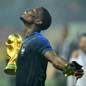 France's Paul Pogba holds the trophy as he celebrates winning the World Cup.