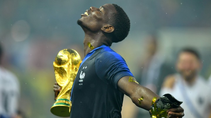 France's Paul Pogba holds the trophy as he celebrates winning the World Cup