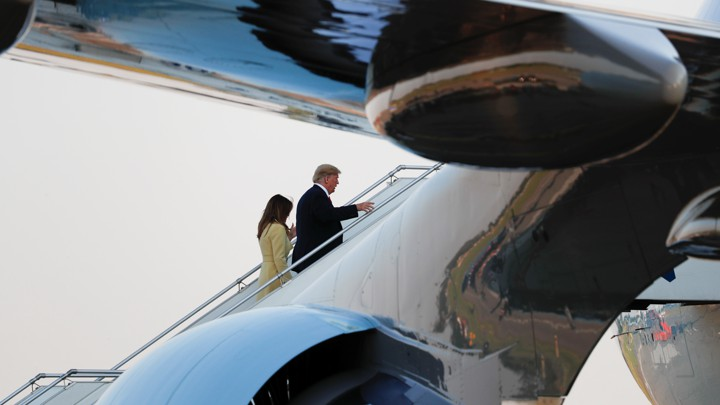 Donald and Melania Trump board Air Force One after the summit in Helsinki