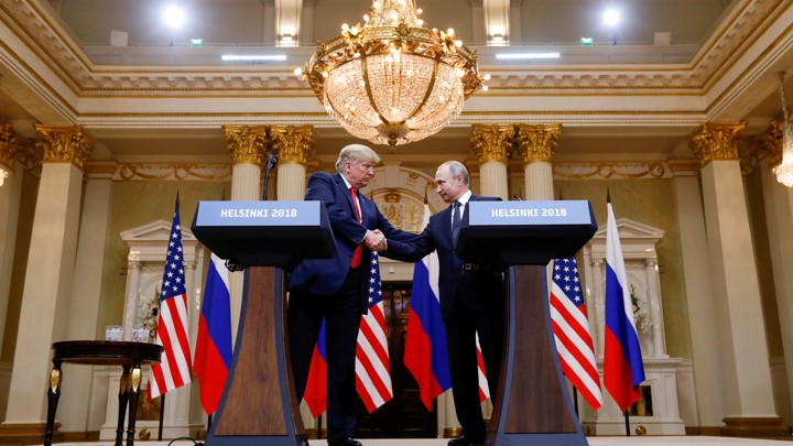 us president donald trump and russias president vladimir putin shake hands during a joint news conference after their meeting in helsinki finland