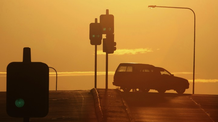 A car turns at a traffic light.