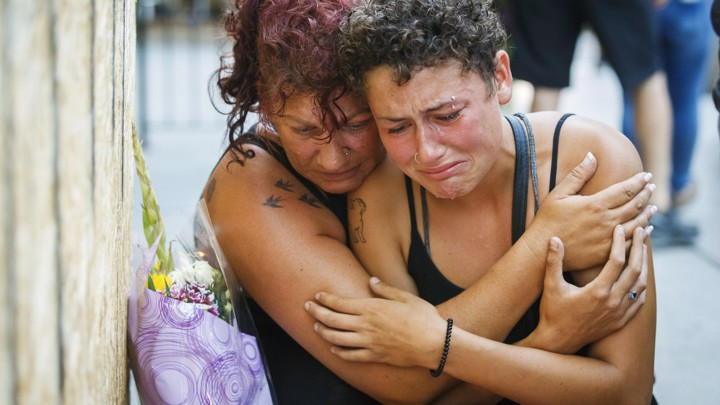 Desirae Shapiro and her mother, Gina Shapiro, friends of the 18-year-old Toronto shooting victim Reese Fallon, mourn after visiting a makeshift memorial
