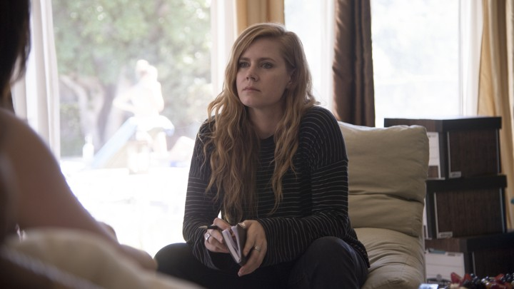"Camille Preaker (Amy Adams) conducts an ""interview"" in the HBO series 'Sharp Objects.'"