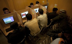 People in an internet cafe in Pakistan