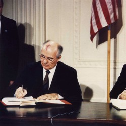 Mikhael Gorbachev and Ronald Reagan sign the Intermediate-Range Nuclear Forces (INF) treaty in 1987