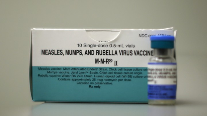 A dose of a measles, mumps, and rubella vaccine