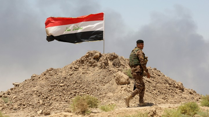 Isis is still in iraq 8 years after end of combat mission the atlantic a soldier walks past an iraqi flag in husaybah anbar province on july 22 2015uters publicscrutiny Gallery
