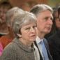 British Prime Minister Theresa May sits next to Chancellor of the Ecxhequer Philip Hammond and Foreign Secretary Jeremy Hunt during an event in London on June 18, 2018.