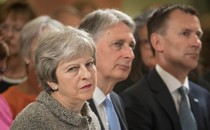 British Prime Minister Theresa May sits next to Chancellor of the Exchequer Philip Hammond and Foreign Secretary Jeremy Hunt during an event in London on June 18, 2018.