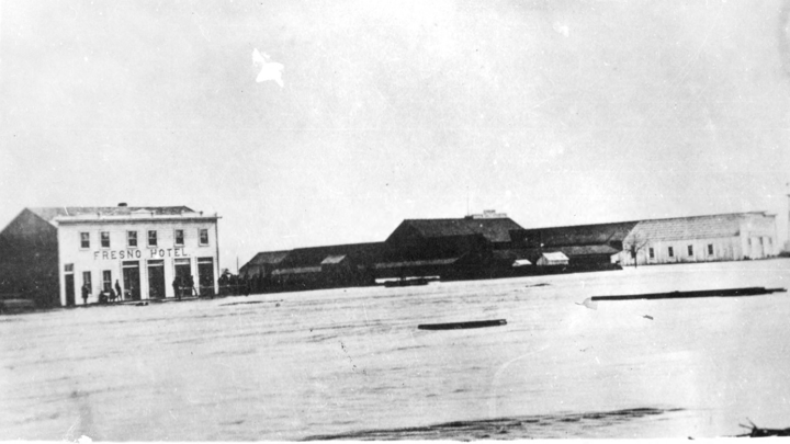 A black-and-white photograph from the 1880s shows the Fresno hotel next to the Fresno train station, the stop on the Southern Pacific Railroad around which the city would develop.