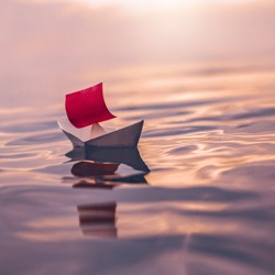 A paper boat on water