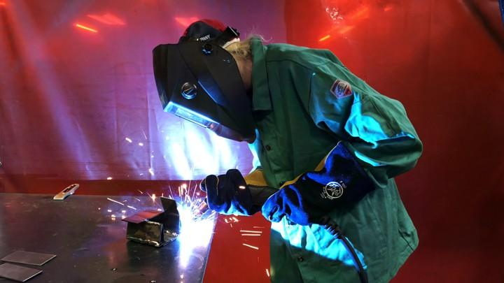 A woman welding