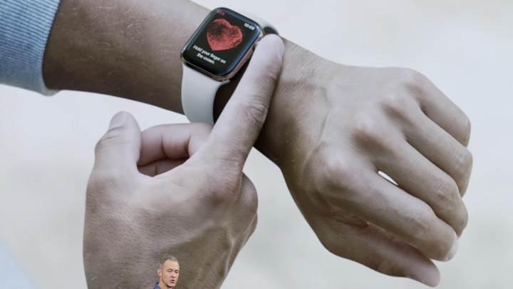 A finger rests on the latest Apple Watch