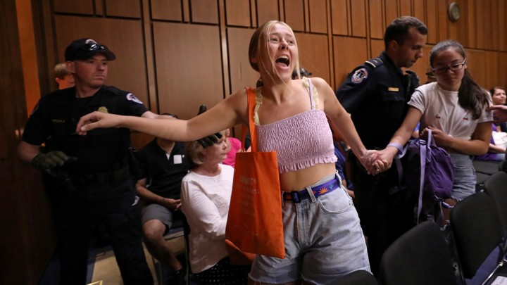 A protester interrupts the Kavanaugh hearings on Friday.
