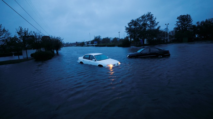 An abandoned car in rising flood waters in Wilmington, North Carolina, on Saturday